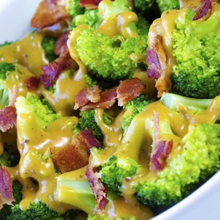 Photoshopped for web broccoli with Irish cheddar sauce